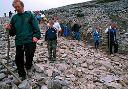 IRELAND CO. MAYO CORAGH PATRICK JUL99 - Pilgrims decend from Croagh Patrick mountain in western Ireland. Around 25,000 people, some of which are bare-footed, participate in this pilgrimage to the top of Croagh Patick mountain on the last Sunday of July from where in 441 A.D. St. Patrick supposedly sent Ireland's reptiles to their doom. ..jre/Photo by Jiri Rezac..© Jiri Rezac 1999..Contact: +44 (0) 7050 110 417.Mobile: +44 (0) 7801 337 683.Office: +44 (0) 20 8968 9635..Email: jiri@jirirezac.com.Web: www.jirirezac.com..© All images Jiri Rezac 1999 - All rights reserved.