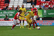 AFC Wimbledon defender Jon Meades (3) is tugged by Charlton Athletic midfielder Ricky Holmes (11) during the EFL Sky Bet League 1 match between Charlton Athletic and AFC Wimbledon at The Valley, London, England on 17 September 2016. Photo by Stuart Butcher.