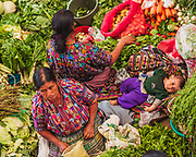 Life in the market of Chichicastanago. Surrounded by valleys with mountains cutting the horizons, Chichicastenango can seem isolated in time and space from the rest of Guatemala. Masheños (citizens of Chichicastenango) are famous for their adherence to pre-Christian beliefs and ceremonies.