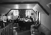 Sheila and Magnus sitting at a table, Glastonbury, Somerset, 1989