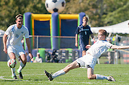 10/10/15 – Medford/Somerville, MA – Tufts midfielder Zach Halliday, A17, slides into a kick in the victory against Middlebury on Saturday, Oct. 10, 2015. (Evan Sayles / The Tufts Daily)
