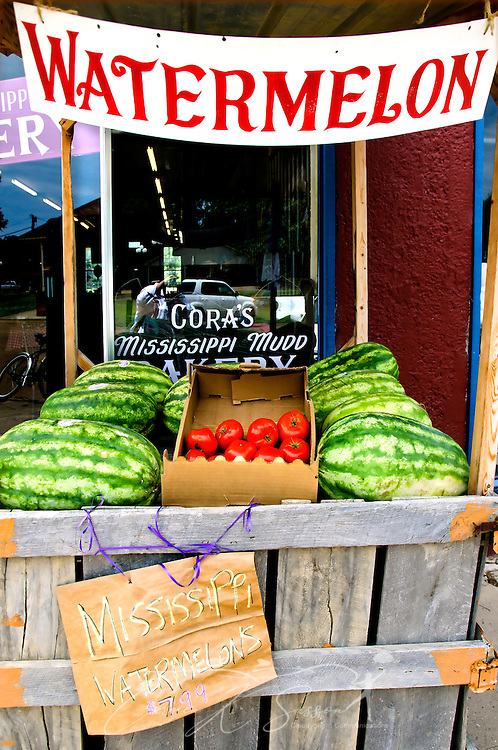 Watermelons can be found everywhere in Water Valley, from paintings on shop windows to lollipops in Turnage Drugstore. Outside B.T.C. grocery, a stand of locally-grown watermelons invites customers to indulge in the summertime treat. (Photo by Carmen K. Sisson/Cloudybright)