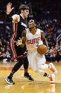 Jan 3, 2017; Phoenix, AZ, USA;  Phoenix Suns guard Eric Bledsoe (2) drives the ball against Miami Heat forward Luke Babbitt (5) in the first half of the NBA game at Talking Stick Resort Arena. Mandatory Credit: Jennifer Stewart-USA TODAY Sports