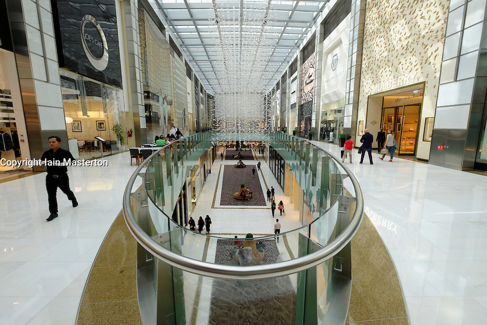 View of upmarket shops and cafes on Fashion Avenue at Dubai Mall in United Arab Emirates