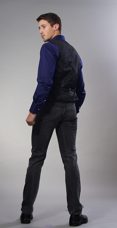 Male model posing in a contemporary outfit.
