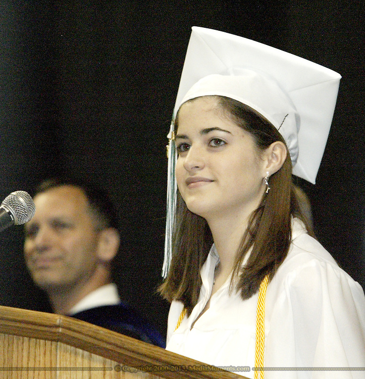 Valedictorian Jennifer Klingle (right) leads the Pledge of Allegiance during the Northmont High School Commencement at the Nutter Center, Sunday, May 25, 2008..