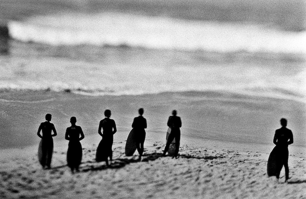 Body boarders on a California beach waiting for the right wave.