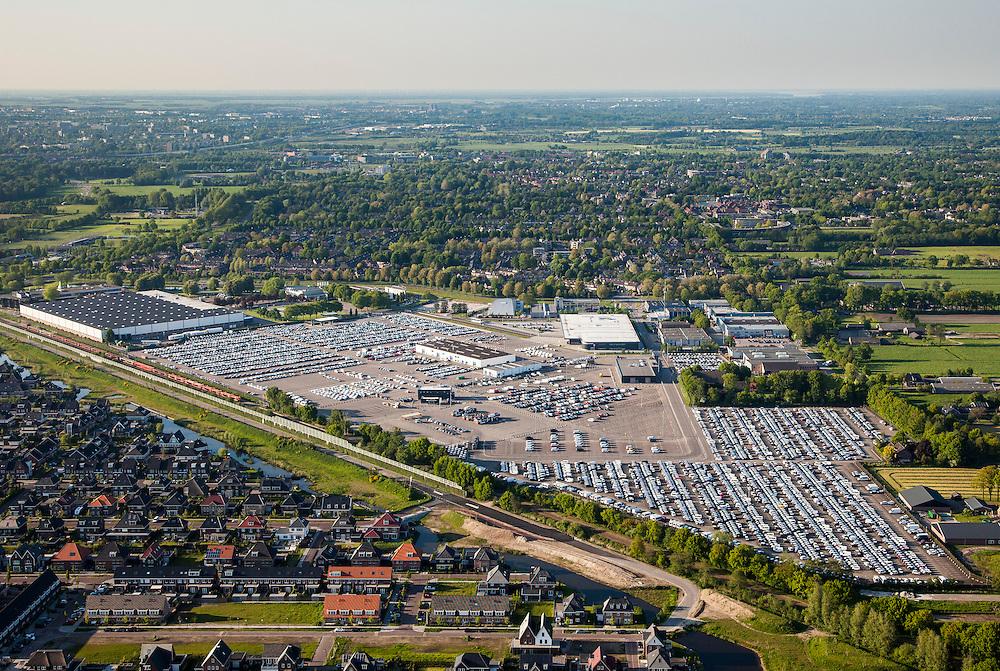 Nederland, Utrecht, Leusden, 27-05-2013; parkeerterrein van automobielbedrijf PON importeur van Volkswagen, Audi, SEAT, Škoda, Porsche, Bentley<br /> Parking PON car dealers and importer.<br /> luchtfoto (toeslag op standaardtarieven);<br /> aerial photo (additional fee required);<br /> copyright foto/photo Siebe Swart.