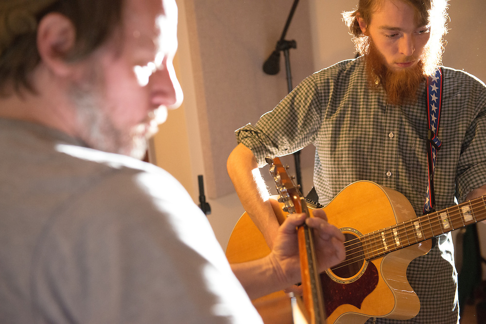 Controlled Folly band members Charles Stanton (Left) and Caleb Brown record a track at MDIA Sound.