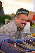 Uzbekistan, Samarqand. Siob Bazaar.<br /> Man with gold teeth.