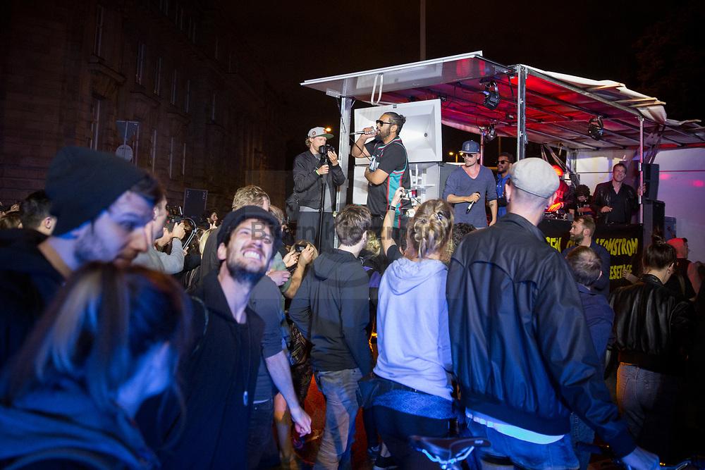 Hamburg, Germany - 05.07.2017<br /> <br /> Spontaneous concert of Samy Deluxe &amp; den Beginnern. Anti-G20 rave under the slogan &rdquo;Lieber tanz ich als G20&rdquo; (&quot;I prefer to dance instead of G20&rdquo;) moves through Hamburg. According to police, about 12,000 people are involved, according to the organizers more than 25,000 people participate.<br /> <br /> Spontan-Konzert von Samy Deluxe &amp; den Beginnern. Anti-G20 Nachttanz-Demo unter dem Motto &rdquo;Lieber tanz ich als G20&rdquo; zieht durch Hamburg. Laut Polizei beteiligen sich etwa 12.000 Personen, laut den Veranstaltern nehmen mehr als 25.000 Menschen teil. <br /> <br /> Photo: Bjoern Kietzmann