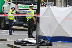 © Licensed to London News Pictures. 15/08/2018. London, UK. Police gather evidence at the scene of an accident at Holborn where a cyclist has died after being hit by a lorry - believed to be former doctor to the Queen Peter Fisher. Photo credit: Rob Pinney/LNP