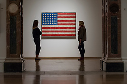 """© Licensed to London News Pictures. 19/09/2017. London, UK. Staff members view """"Flag"""", 1958, by Jasper Johns.  Preview of a landmark exhibition by Jasper Johns RA called """"Something Resembling Truth"""" at the Royal Academy of Arts in Piccadilly.  Sculptures, drawing, prints plus new works are on display 25 September to 10 December 2017.   Photo credit : Stephen Chung/LNP"""