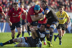 December 9, 2018 - Limerick, Ireland - Tadhg Beirne of Munster tackled by Thibault Lassalle and Mathieu Babillot of Castres during the Heineken Champions Cup Round 3 match between Munster Rugby and Castres Qlympique at Thomond Park Stadium in Limerick, Ireland on December 9, 2018  (Credit Image: © Andrew Surma/NurPhoto via ZUMA Press)
