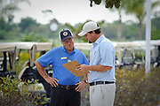Golf Pro Michael Eye at Pipers Landing Country Club talks to one of the starters at the Golf Club