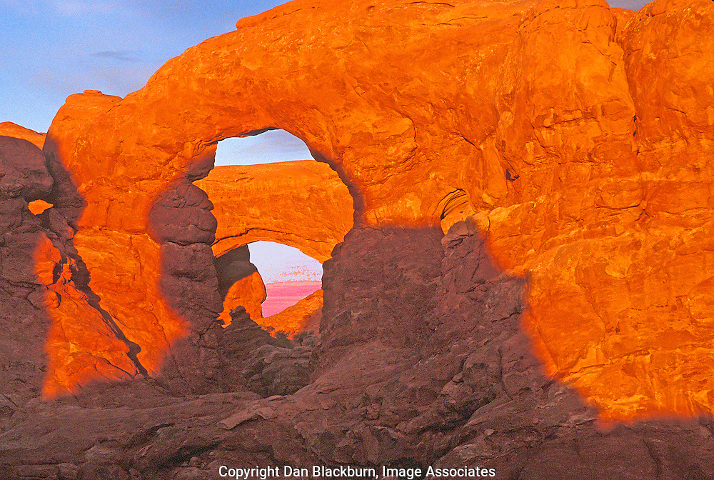Sunlight on Turret Arch and South Window in the Red Rock of Arches National Park Utah