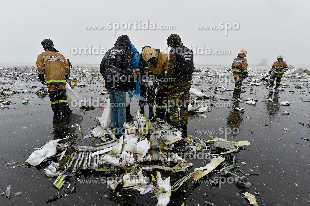 Rescuers work at the crash site of the Boeing 737-800 Flight FZ981 operated by Dubai-based budget carrier Flydubai, at the airport of Rostov-On-Don, Russia, on March 19, 2016. One of the two flight recorders of the Flydubai Boeing 737-800 airliner was found at the crash site at the Rostov-on-Don airport in Russia's southwest Rostov region, and the search for the second one is ongoing, the RIA Novosti news agency reported. EXPA Pictures &copy; 2016, PhotoCredit: EXPA/ Photoshot/ RIA Novosti<br /> <br /> *****ATTENTION - for AUT, SLO, CRO, SRB, BIH, MAZ, SUI only*****