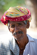 Indian man wears traditional Rajasthani turban in Jaipur, Rajasthan, Northern India