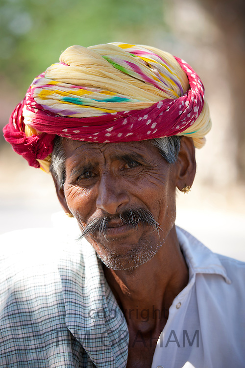 Indian man wears traditional Rajasthani turban in Jaipur, Rajasthan, Northern India
