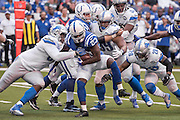 September 11, 2016: Detroit Lions defensive tackle Tyrunn Walker (93) and Detroit Lions cornerback Quandre Diggs (28) tackle Indianapolis Colts running back Frank Gore (23) during the week 1 NFL game between the Detroit Lions and Indianapolis Colts at Lucas Oil Stadium in Indianapolis, IN.  (Photo by Zach Bolinger/Icon Sportswire)