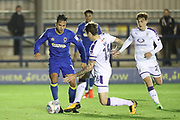 AFC Wimbledon attacker Harry Forrester (11) taking on Luton Town defender Glen Rea (16) during the EFL Trophy match between AFC Wimbledon and Luton Town at the Cherry Red Records Stadium, Kingston, England on 31 October 2017. Photo by Matthew Redman.