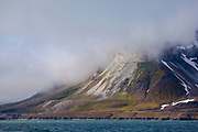 A cloud caps a mountain on the Isjforden, Svalbard