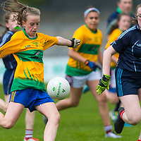 Eabha O'Driscoll raises a white flag with this effort past Norah Ryan.<br /> <br /> Division 1 between Barefield NS and Knockanean NS in the Clare Primary Schools Ladies Football Finals at Cusack Park, Ennis, Co. Clare