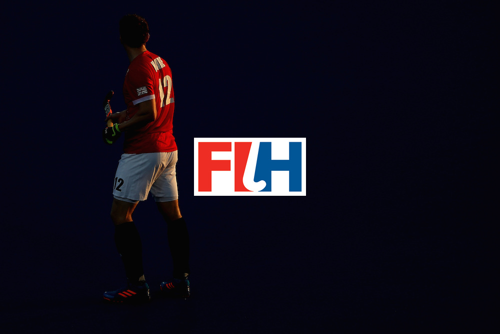 RIO DE JANEIRO, BRAZIL - AUGUST 12:  Michael Hoare #12 of Great Britain walks upfield against Spain during a Men's Preliminary Pool B match on Day 7 of the Rio 2016 Olympic Games at the Olympic Hockey Centre on August 12, 2016 in Rio de Janeiro, Brazil.  (Photo by Sean M. Haffey/Getty Images)