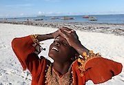 A child is photographed on the beach in Matwemwe, Zanzibar.