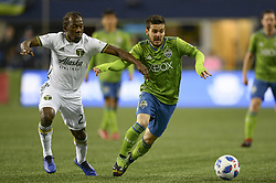 November 8, 2018 - Seattle, Washington, U.S - Seattle's VICTOR RODRIGUEZ (8) and Portland's DIEGO CHARA (21) battle for the ball as the Portland Timbers visit the Seattle Sounders in a MLS Western Conference semi-final match at Century Link Field in Seattle, WA. (Credit Image: © Jeff Halstead/ZUMA Wire)