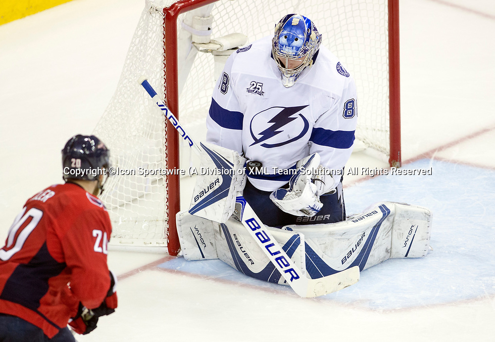 WASHINGTON, DC - MAY 21: Tampa Bay Lightning goaltender Andrei Vasilevskiy (88) makes a save on a close in shot from Washington Capitals center Lars Eller (20) in the third period during game 6 of the NHL Eastern Conference  Finals between the Washington Capitals and the Tampa Bay Lightning, on May 21, 2018, at Capital One Arena, in Washington D.C. The Caps defeated the Lightning 3-0<br /> (Photo by Tony Quinn/Icon Sportswire)