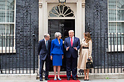 UNITED KINGDOM, London: 04 June 2019 <br /> The President of the United States of America Donald Trump arrives at 10 Downing Street this morning with his wife Melania and is welcomed by British Prime Minster Theresa May and her husband Philip during The President's official state visit.