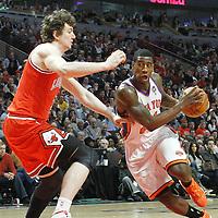 12 March 2012: New York Knicks guard Iman Shumpert (21) drives past Chicago Bulls center Omer Asik (3) during the Chicago Bulls 104-99 victory over the New York Knicks at the United Center, Chicago, Illinois, USA.