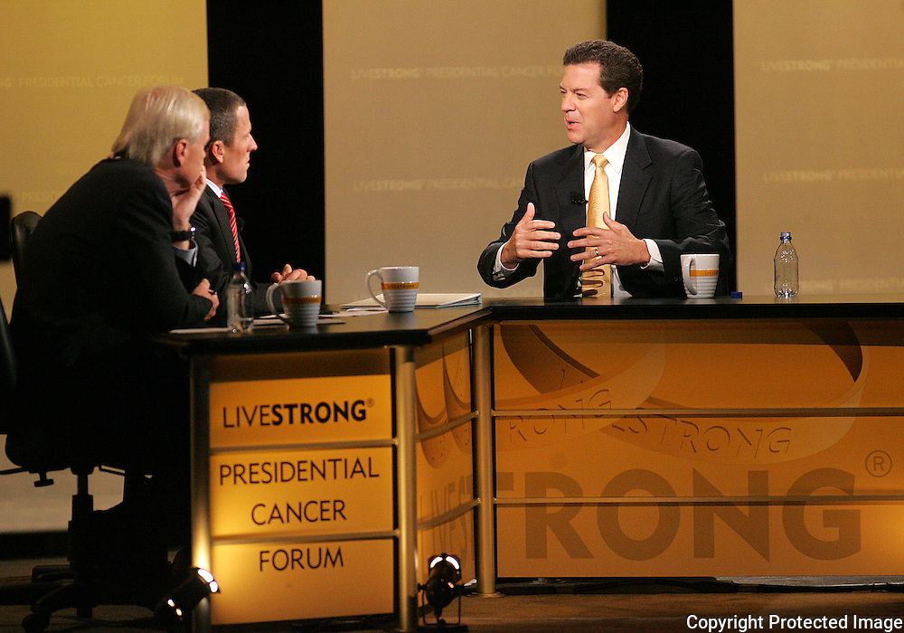 28 August 2007: MSNBC Hardball host Chris Matthews (left) and seven-time Tour de France winner Lance Armstrong (center) listen to Republican presidential hopeful and Senator Sam Brownback (R-KS) (right) answer a question at the LIVESTRONG Presidential Cancer Forum in Cedar Rapids, Iowa on August 28, 2007.