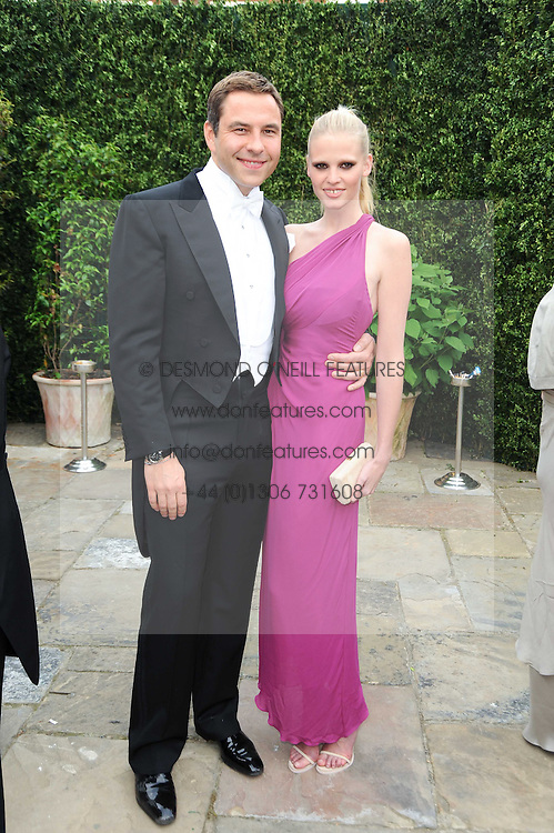 DAVID WALLIAMS and his wife LARA STONE at the Raisa Gorbachev Foundation Party held at Stud House, Hampton Court Palace on 5th June 2010.  The night is in aid of the Raisa Gorbachev Foundation, an international fund fighting child cancer.