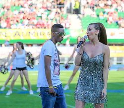 07.06.2014, Ernst Happel Stadion, Wien, AUT, American Football Europameisterschaft 2014, Finale, Oesterreich (AUT) vs Deutschland (GER), im Bild Cathy Zimmermann und der Rapper Emanuel // during the American Football European Championship 2014 final game between Austria and Denmark at the Ernst Happel Stadion, Vienna, Austria on 2014/06/07. EXPA Pictures © 2014, PhotoCredit: EXPA/ Thomas Haumer