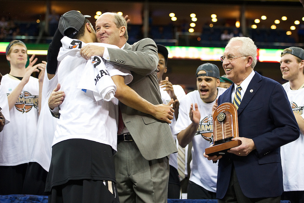 New Orleans , LA. - Game 11 of the 2012 SEC Men's Basketball Tournament between Kentucky and Vanderbilt, was played Sunday, March 11, 2012 at the New Orleans Arena. Vanderbilt head coach Kevin Stallings hugs guard John Jenkins, left, before he is presented the 2012 SEC Tournament MVP award, by SEC commissioner Mike Slive after Vanderbilt defeated Kentucky 71-64.