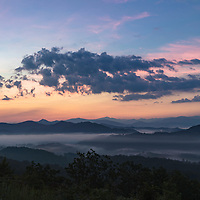 Twilight colors light up the sky above the Smoky Mountains