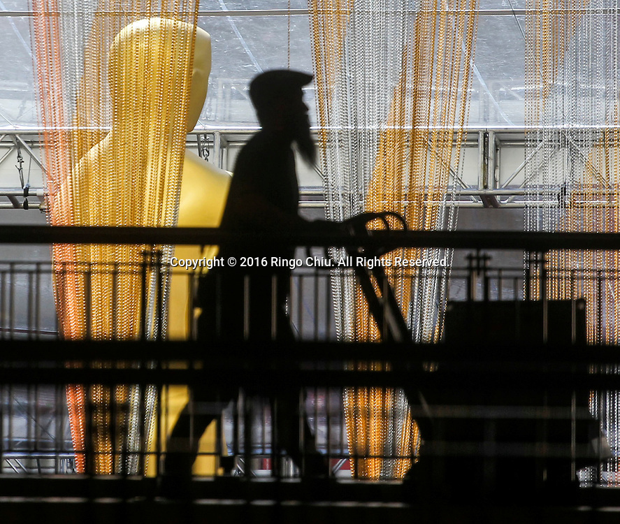 A worker walks by the Oscar statue in front of the Dolby Theatre in Los Angeles, Wednesday, February 24, 2016. The 88th Academy Awards will be held Sunday, February 28, 2016. (Photo by Ringo Chiu/PHOTOFORMULA.com)<br /> <br /> Usage Notes: This content is intended for editorial use only. For other uses, additional clearances may be required.