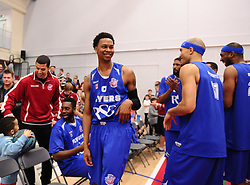 Bristol Flyers' Bree Perine is congratulated by team mates after a fine game  - Photo mandatory by-line: Joe Meredith/JMP - Mobile: 07966 386802 - 21/02/2015 - SPORT - Basketball - Bristol - SGS Wise Campus - Bristol Flyers v Plymouth Uni Raiders - British Basketball League