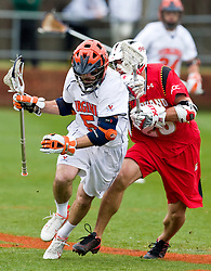 Virginia Cavaliers M/A Steve Giannone (5) runs past Maryland Terrapins Midfield Jeff Reynolds (28).  The #9 ranked Maryland Terrapins fell to the #1 ranked Virginia Cavaliers 10 in 7 overtimes in Men's NCAA Lacrosse at Klockner Stadium on the Grounds of the University of Virginia in Charlottesville, VA on March 28, 2009.
