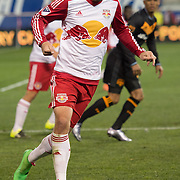 Mar 19, 2016; Harrison, NJ, USA;New York Red Bulls midfielder Sacha Kljestan (16) dribbles the ball against the Houston Dynamoin the second half at Red Bull Arena. Red Bulls defeat the Dynamo 4-3. Mandatory Credit: William Hauser-USA TODAY Sports