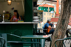 PORTUGAL LISBON 6OCT06 - A cafe with a fado musician on Cerca Moura square offering nice views over the Alfama district.. . jre/Photo by Jiri Rezac. . © Jiri Rezac 2006. . Contact: +44 (0) 7050 110 417. Mobile:  +44 (0) 7801 337 683. Office:  +44 (0) 20 8968 9635. . Email:   jiri@jirirezac.com. Web:    www.jirirezac.com. . © All images Jiri Rezac 2006 - All rights reserved.