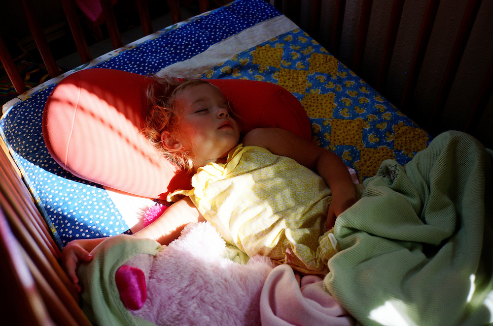 Madelyn Avery Eich, 2, naps in her crib in her home in Norfolk, Virginia on Sunday, July 25, 2010.