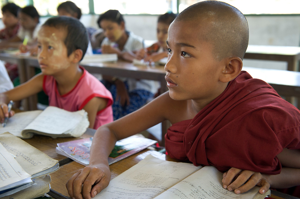 Children made orphans by Cyclone Nargis live and study at a Monastery in Dalah, Yangon (Rangoon) Myanmar (Burma) January 2012