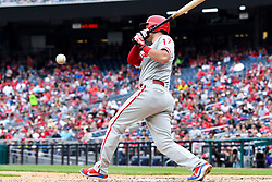 May 6, 2018 - Washington, DC, U.S. - WASHINGTON, DC - MAY 06:  Philadelphia Phillies left fielder Rhys Hoskins (17) hits a foul ball into the photo well during the game between the Philadelphia Phillies  and the Washington Nationals on May 6, 2018, at Nationals Park, in Washington D.C.  The Washington Nationals defeated the Philadelphia Phillies, 5-4.  (Photo by Mark Goldman/Icon Sportswire) (Credit Image: © Mark Goldman/Icon SMI via ZUMA Press)