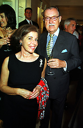 TV travel presenter MR ALAN WHICKER and MISS VALERIE KLEEMAN, at a party in London on 21st September 1999.MWO 99