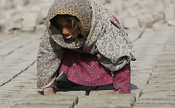 A child works at a brick factory in Nangarhar province, eastern Afghanistan, on Feb. 11, 2013. The child labor has remained rampant in brick kiln industry of the country., Monday February 11, 2013. Photo by Imago / i-Images. UK ONLY..