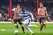 Queens Park Rangers Midfielder Bright Osayi-Samuel (20) makes a run at goal with Brentford Defender Henrik Dalsgaard (22) and Brentford Midfielder Emiliano Marcondes (17) putting him under pressure during the EFL Sky Bet Championship match between Brentford and Queens Park Rangers at Griffin Park, London, England on 2 March 2019.