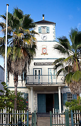 Philipsburg, St. Maarten:  The island's old Dutch courthouse, built in 1793 and periodically restored, stands at the end of Cyrus Whathey Square, surrounded by literally hundreds of jewelry and souvenir stores aimed at snagging cruise passenger dollars.  Note the golden pineapple atop the clock tower, the traditional symbol of hospitality.<br />